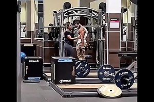 Couple Giving a kiss in Gym