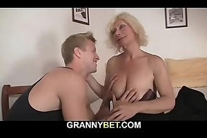 Pretty blonde nourisher receives doggy-fucked