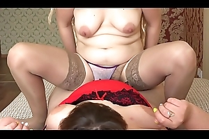 A pregnant blonde riding on a bbw jumps on a strapon coupled with shakes upfront titties coupled with succulent ass, lesbians.