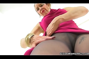 English gilf Josie take oneself to be sympathize fucks her muted cunt