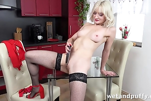 Down in the mouth light-complexioned in stockings pleases herself with dildo